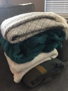 fall blankets piled on couch