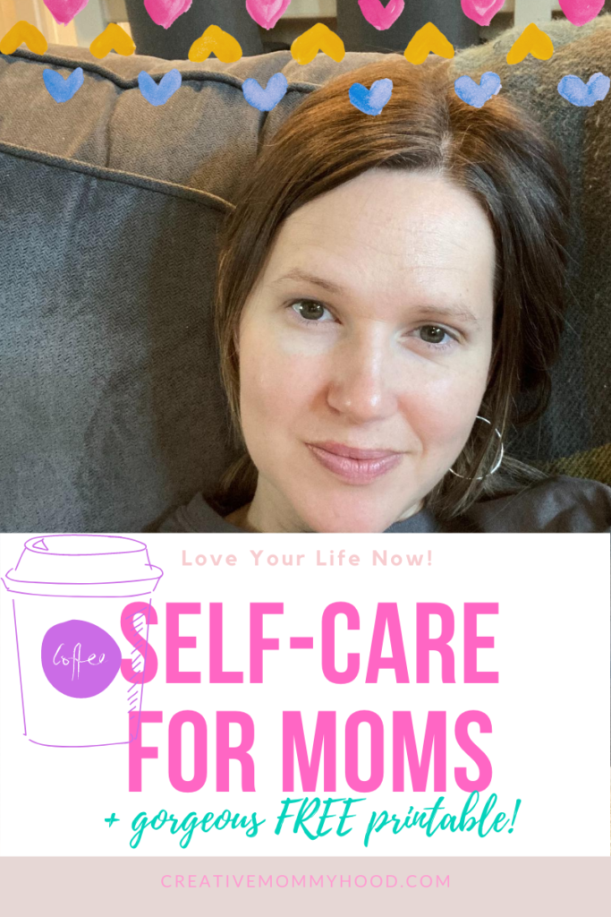 A mom sitting on the couch, smiling and enjoying self-care