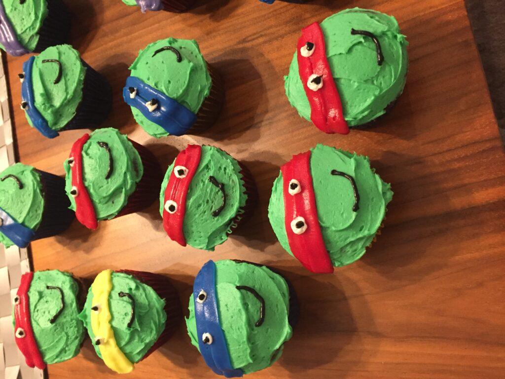 Ninja turtle faces on cupcakes